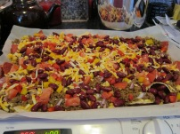 Tortilla chips, leftover taco beef, marble cheddar, fresh tomato, red pepper, yellow pepper, red onion, red kidney beans.