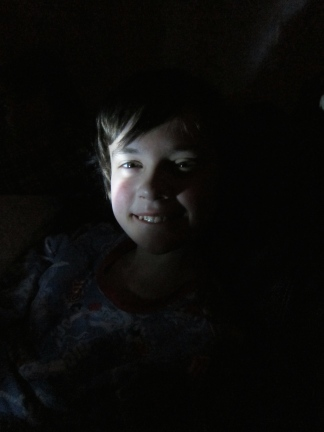 Thing 1 in the dark. Light provided by his Dynamo flashlight.