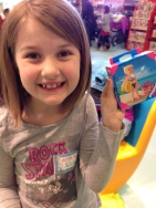 """Thing 2 won a prize during the """"test"""" flights of her paper airplane. Cool!"""