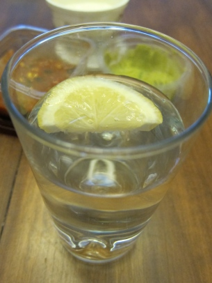 Water with lemon is the perfect accompaniment. It's better with lime, but have you seen the price of limes?! Yikes!