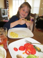 "Thing 2 is not a big fan of eggs, but she likes ""scrambled"". Her brinner burrito was filled with avocado and tomatoes!"