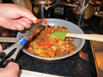 "Thing 1 took this ""action"" shot of one of my tricks. I'm snipping red pepper strips with my kitchen scissors. Easy peasy!"