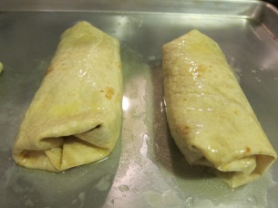Once they are wrapped and the seem side is down, brush with the melted butter.