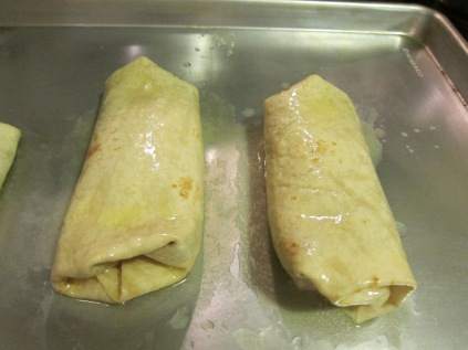 The butter will coat the tortillas and make a nice crispy Chimichanga, without deep frying. A little brush of butter goes a long way! (and as you can clearly see a lot just rolls down to the sheet pan.)