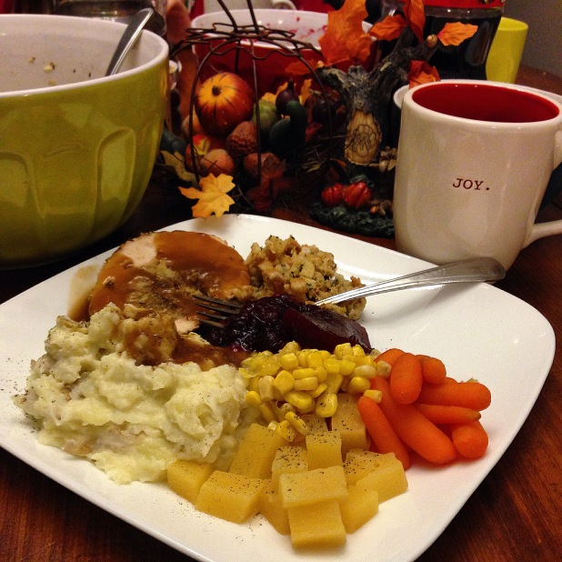 Thanksgiving dinner turkey stuffing dressing mashed potatoes carrots turnip rutabaga gravy peaches and cream corn